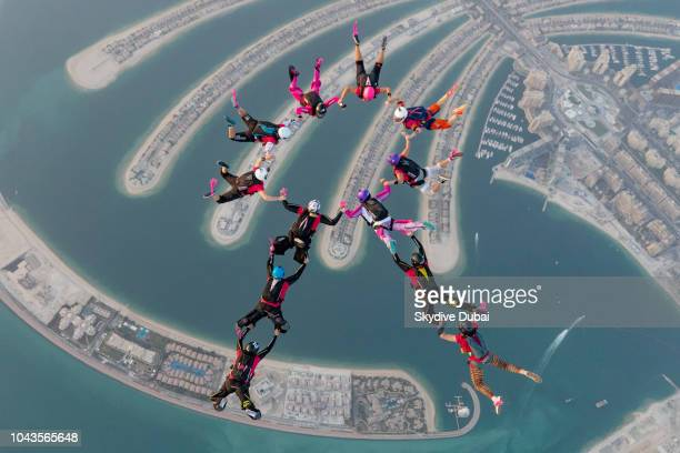 12 female skydivers both staff and customers form a pink ribbon above the Palm Jumeirah Island as part Skydive Dubai's October Breast Cancer...
