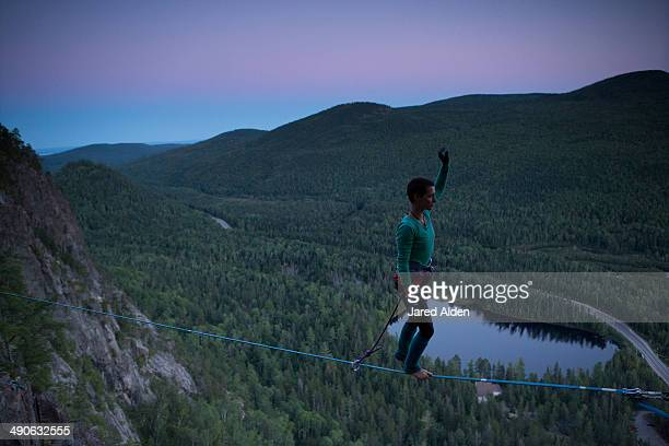 Female slackliner walking a highline