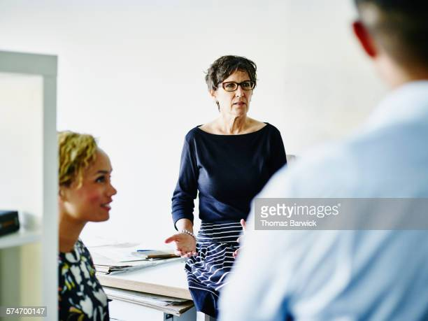 Female small business owner leading meeting