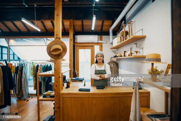 female small business owner ready to accept mobile payment via digital tablet - boutique stock pictures, royalty-free photos & images
