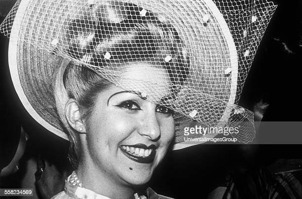 Female smiling wearing a veil hat at The Blitz club London UK 1980 81