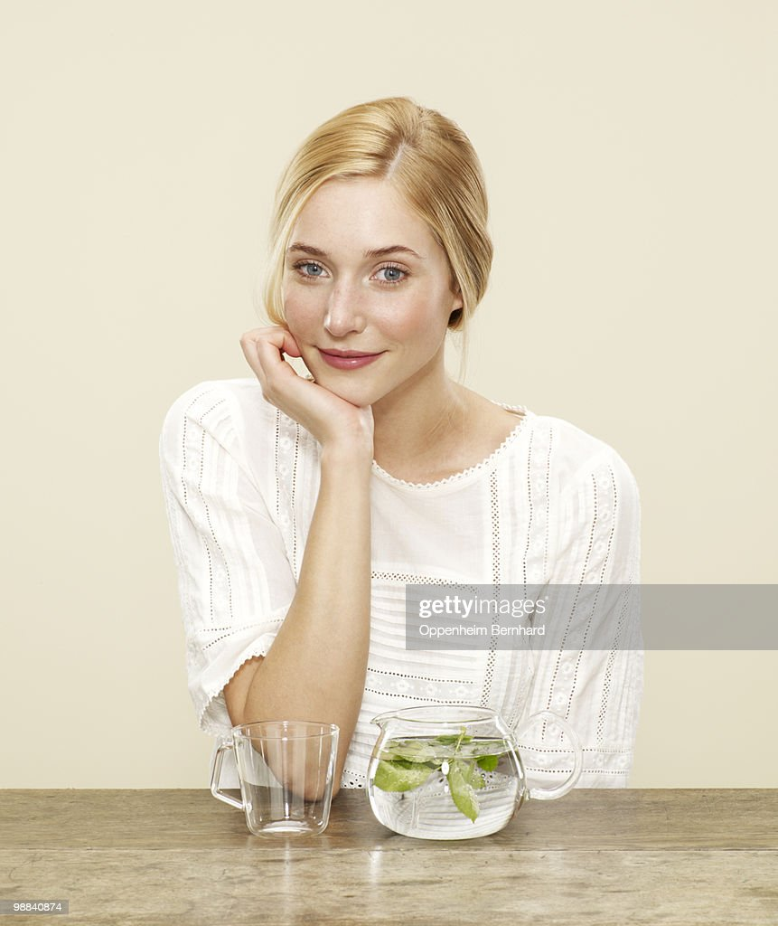 female smiling with fresh brewing tea : Stock Photo