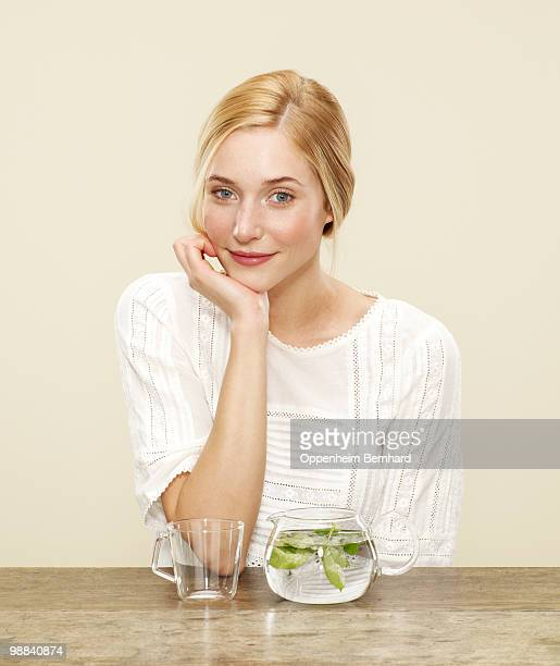 female smiling with fresh brewing tea