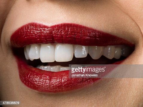 Female Smiling With Red Lipstick On Perfect Teeth Stock