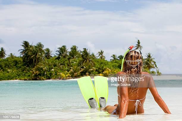 Female snorkeler, Medahutthaa Island, North Huvadhu Atoll, Maldives