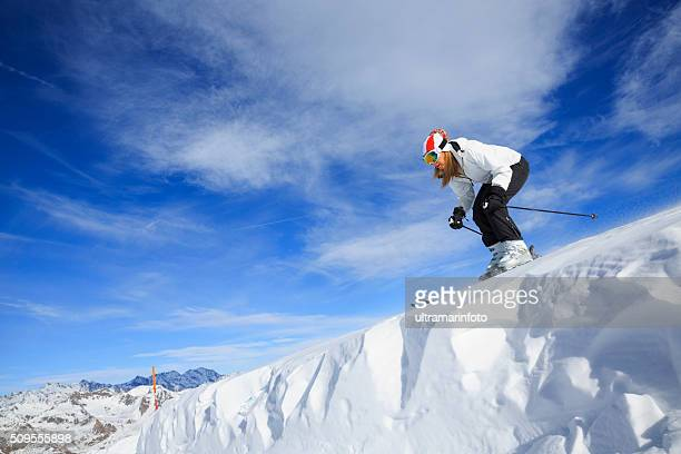 Female snow skier alpine skiing  High mountain winter landscape