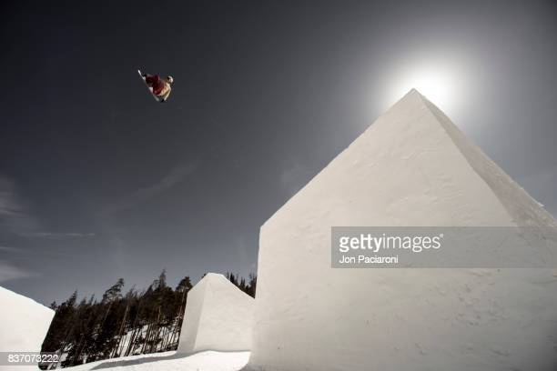 female snowboarder getting big air off of a massive jump - big air bildbanksfoton och bilder