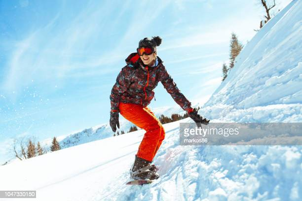 female snowboarder having fun on ski track - ski goggles stock pictures, royalty-free photos & images
