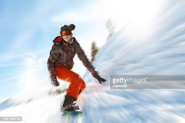 Female snowboarder having fun on ski track