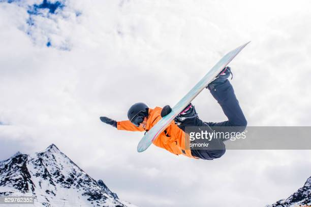 Female snowboarder in mid air