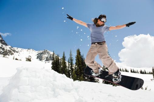 female snowboarder jumping through air - gettyimageskorea