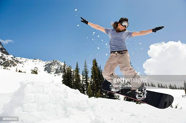 female snowboarder jumping through air - female skier stock pictures, royalty-free photos & images