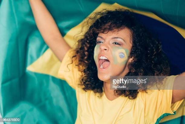Female soccer fan supporting Brazilian soccer team