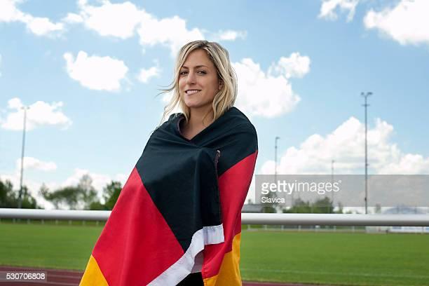Female soccer fan wrapped in German flag, Munich, Bavaria, Germany