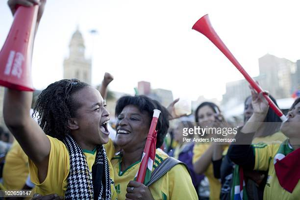 Female soccer fans reacts to a game between South Africa and France shown on giant monitors on June 22 in central Cape Town South Africa Thousands of...