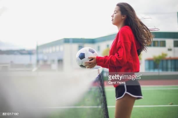 Female soccer girl holding soccer ball