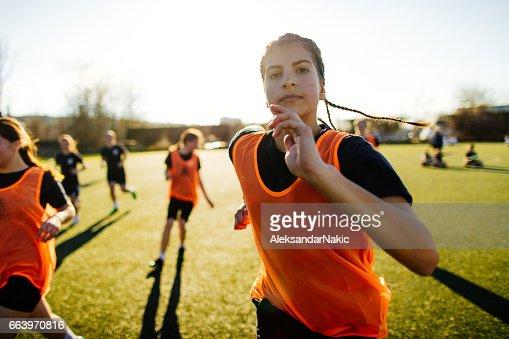 Joueur de soccer féminin et son équipe