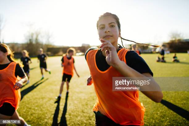 female soccer player and her team - sport stock pictures, royalty-free photos & images