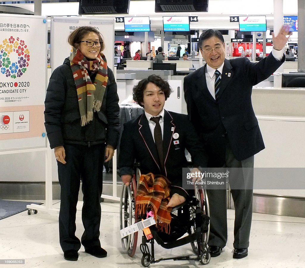 Female Soccer player Homare Sawa, Paralympic swimmer Takayuki Suzuki and Tokyo 2020 Olympic Games bidding committee CEO Masato Mizuno pose for photographs as they depart to Lausanne to hand in their candidate file at Narita International Airport on January 6, 2013 in Narita, Chiba, Japan.