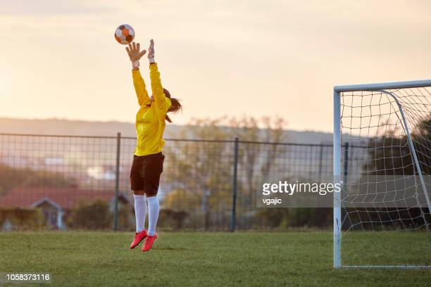 female soccer player - sports training drill stock pictures, royalty-free photos & images