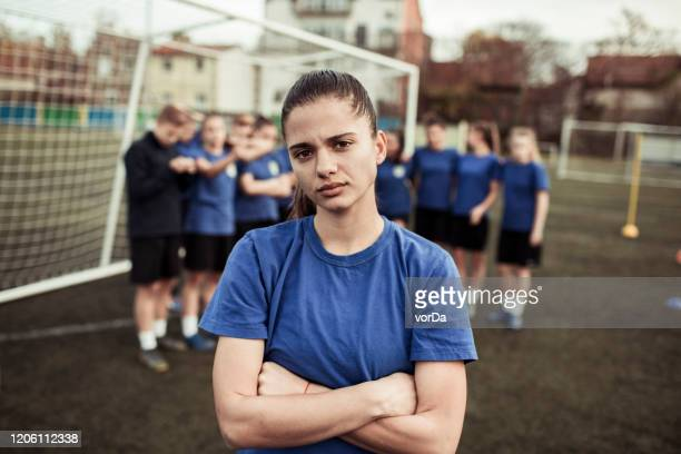 female soccer player - club football stock pictures, royalty-free photos & images