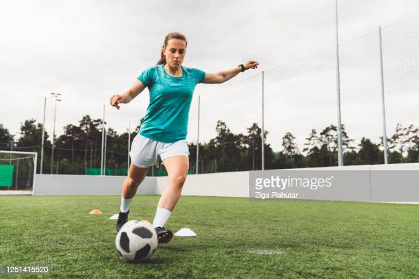 female soccer player - football stock pictures, royalty-free photos & images