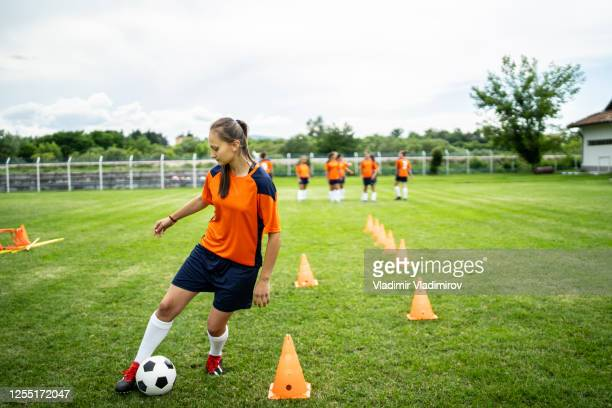 female soccer player practicing - high school football stock pictures, royalty-free photos & images