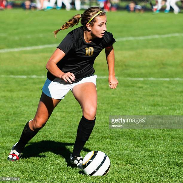 Female Soccer Player Showing Mega Intensity with Eyes Up Downfield
