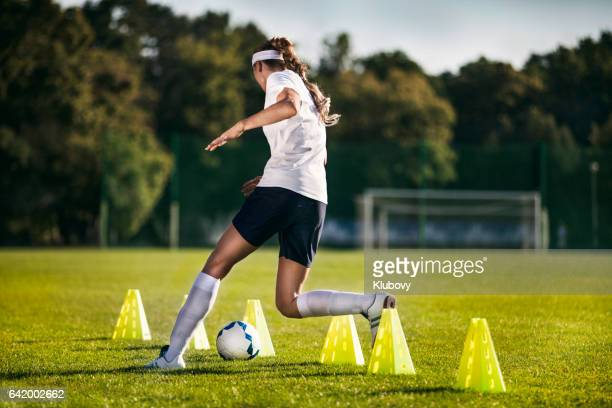 Female soccer player - slalom drills training
