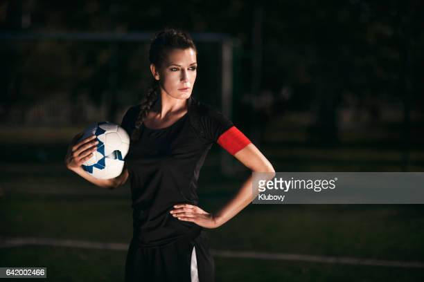 female soccer player - team captain - team captain stock pictures, royalty-free photos & images