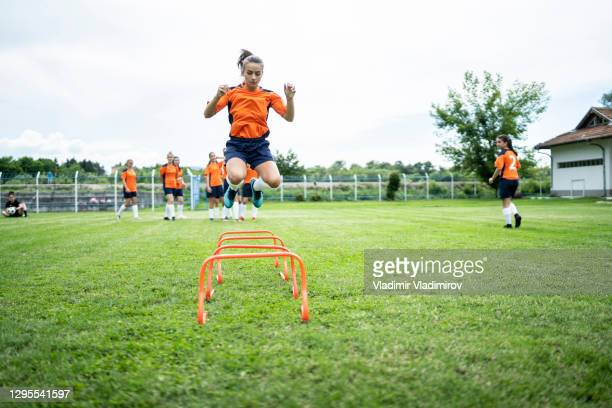 female soccer player training - high school football stock pictures, royalty-free photos & images