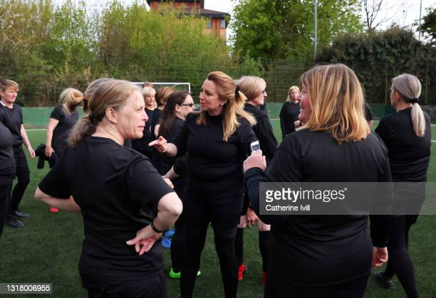 female soccer players interacting on soccer pitch - organised group stock pictures, royalty-free photos & images
