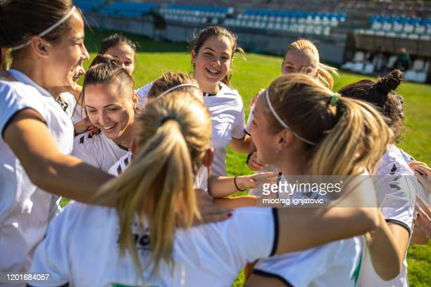 female soccer team celebrating great victory - football team stock pictures, royalty-free photos & images