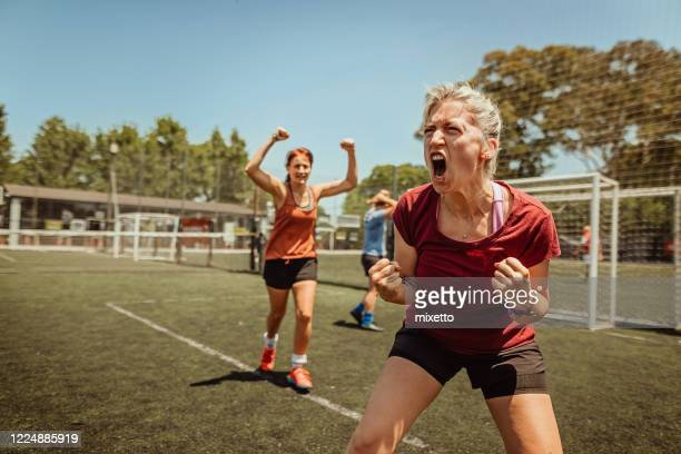 female soccer team celebrating victory - scoring a goal stock pictures, royalty-free photos & images
