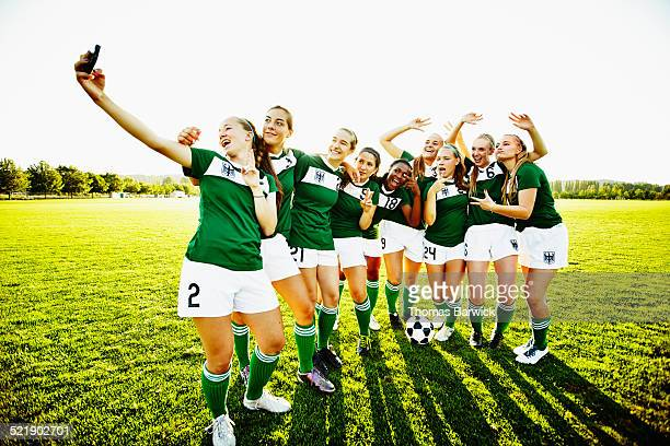 Female soccer teammates taking self portrait