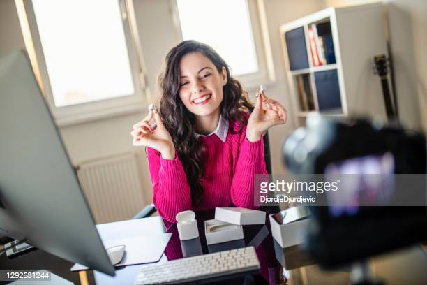 female social media technology influencer recording unboxing video at home - unboxing stock pictures, royalty-free photos & images