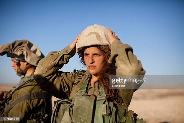 A female soldier from the 'Karakal' Battalion in action during training near the IsraeliEgyptian border on December 14 2010 near Azoz Israel The...