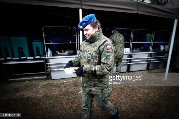 A female soldier is seen at the military picnic in Bydgoszcz Poland on March 9 2019 on the occasion of Poland's 20th anniversary of joining NATO