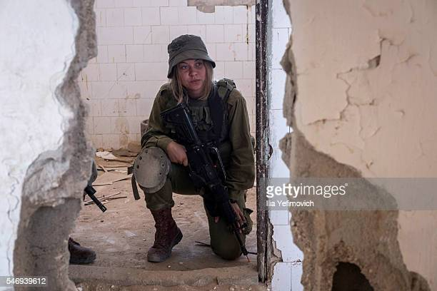 A female soldier looks out as Israeli male and female combat soldiers of the Bardales battalion take part in a long day of practise in a heavy fog on...