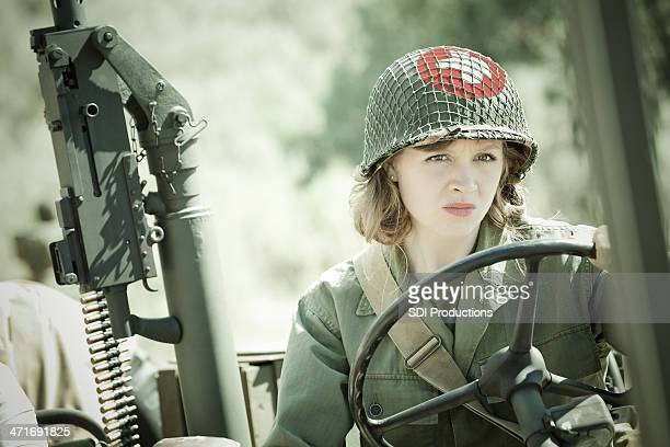 wwii female soldier medic driving military vehicle - military doctor stock photos and pictures