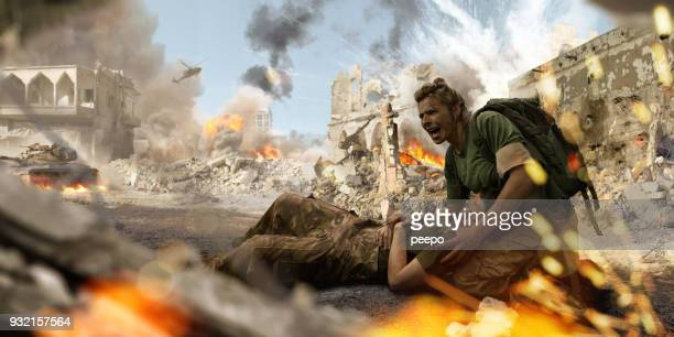 female soldier medic helping injured female soldier in war zone - war stock pictures, royalty-free photos & images