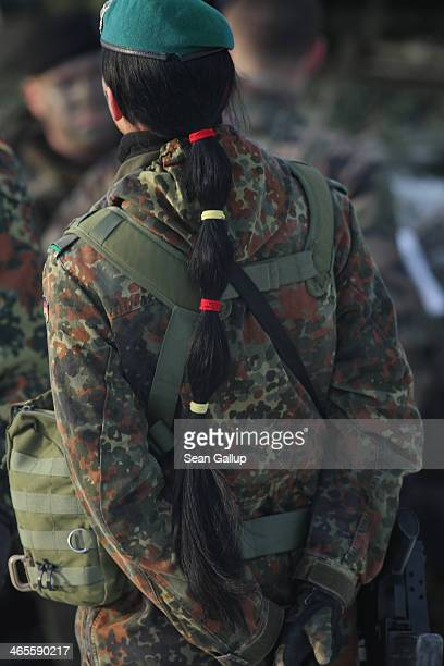A female soldier of the Bundeswehr participates in military exercises during a visit by German Defense Minister Ursula von der Leyen at the...