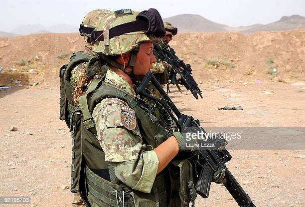 A female soldier of the Folgore Parachute Brigade prepares before an excercise in the military shooting centre on September 17 2009 in Shindand...