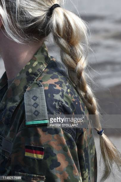 A female soldier of the German armed forces Bundeswehr is pictured during an educational practice of the Very High Readiness Joint Task Force as part...