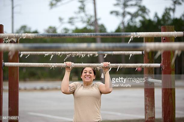 female soldier on obstacle course - clenching teeth stock pictures, royalty-free photos & images