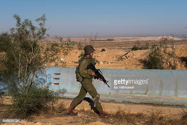 A female soldier patrols as Israeli male and female combat soldiers of the Bardales battalion take part in a long day of practise in a heavy fog on...