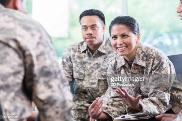 female soldier talks during support group meeting - military uniform stock pictures, royalty-free photos & images