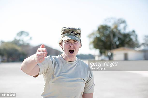 Female soldier trainer shouting at air force military base