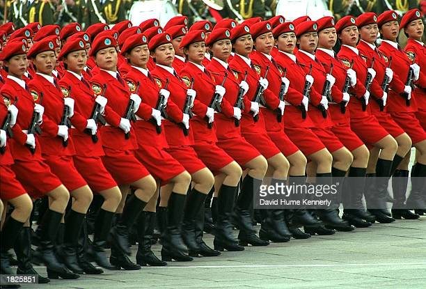 Female soldiers march in the 50th Anniversary of the Peoples Republic of China parade October 1 1999 in Tiananmen Square October 1 1999 in Beijing...