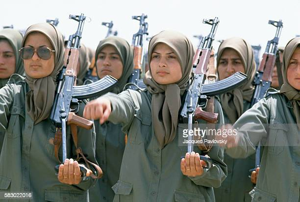 Female soldiers of the NLA stand in formation holding AK47s at a training camp east of Baghdad Iraq Women make up nearly half of the NLA the armed...